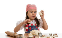 Girl making forms out of dough Royalty Free Stock Photos