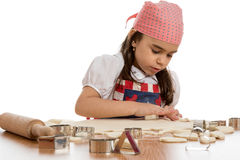 Girl making forms out of dough Stock Photos