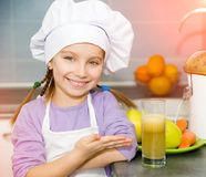 Girl  making fresh juice Royalty Free Stock Image