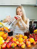 Girl making fruits beverages with alcohol Stock Images
