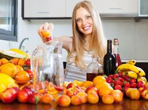 Girl making fruits beverages with wine Royalty Free Stock Photography
