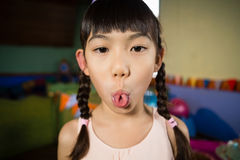 Girl making funny faces during birthday party at home Royalty Free Stock Photography