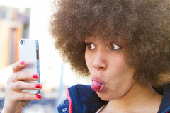 Girl making a funny selfie Stock Images