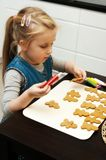 Girl making gingerbread cookies for Christmas Stock Photography