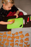 Girl making gingerbread cookies for Christmas Stock Images