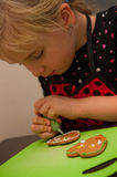 Girl making gingerbread cookies for Christmas Royalty Free Stock Photos
