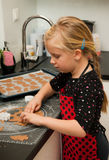 Girl making gingerbread cookies Royalty Free Stock Photo