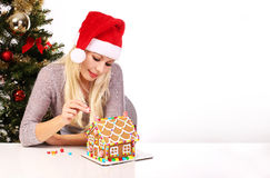 Girl making gingerbread house Stock Photo