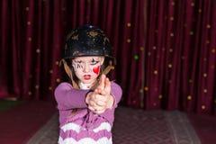 Girl Making Gun with Hands and Aiming at Camera Stock Photography