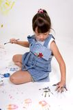 Girl making handprints. Stock Image