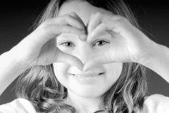 Girl making heart. Happy young girl making heart shape out of hands Royalty Free Stock Photos