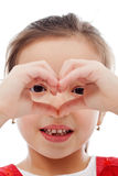 Girl making heart sign Stock Images