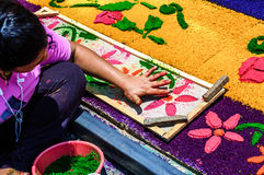 Girl making Holy Week processional carpet, Antigua, Guatemala. Antigua, Guatemala - April 2, 2015: Girl making Holy Week processional carpet (alfombra) using royalty free stock images