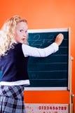 Girl making homework Stock Image