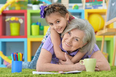 Girl making homework with granny Royalty Free Stock Photos