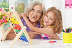 Girl making homework with granny Royalty Free Stock Photo