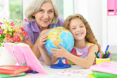 Girl making homework with granny Royalty Free Stock Images