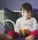 Girl making inhalation with mask on her face Stock Photos