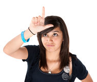 Girl Making the Loser Sign on her Forehead Royalty Free Stock Photos