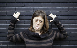 Girl making mockery. In urban street Royalty Free Stock Images