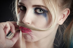 Girl making mustache. Fun blond girl making fake mustache from her hair Royalty Free Stock Photo