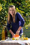 Girl making natural lemonade Stock Images