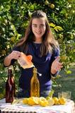 Girl making natural lemonade Royalty Free Stock Photography