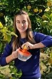 Girl making natural lemonade Stock Photo