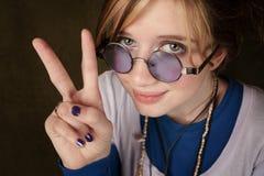 Girl Making Peace Sing Stock Photo