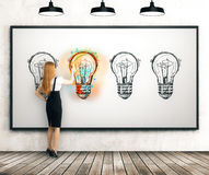Girl making a perfect light bulb sketch Royalty Free Stock Image
