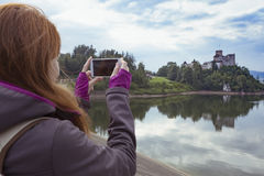 Girl making a photo shoot of castle niedzica Stock Photos