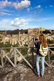 Girl making a photo shoot of old city sorano. Italy Stock Image