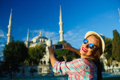 Girl  making photo by the smartphone near the Blue Mosque, Istan Stock Photography
