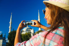 Girl  making photo by the smartphone near the Blue Mosque, Istan Royalty Free Stock Photos