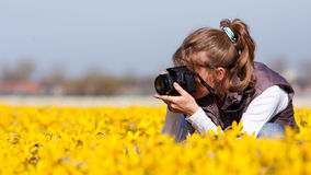 Girl making pictures of flowers Royalty Free Stock Images