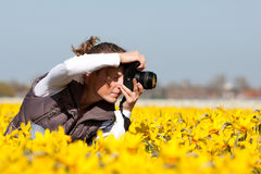 Girl making pictures of flowers Royalty Free Stock Photography