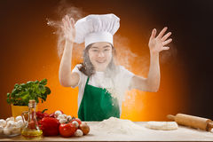 Girl making pizza dough Royalty Free Stock Images