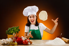 Girl making pizza dough Royalty Free Stock Photo