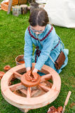 Girl making pottery on a medieval happening at Castelgrande cast. Bellinzona, Switzerland - 21 May 2017: girl making pottery on a medieval happening at Stock Images