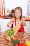 Girl making salad Royalty Free Stock Photo