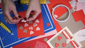 Girl making scrap Valentine greeting card. Hands of girl making scrap Valentine greeting card stock footage