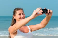 Girl making self photo Stock Photo