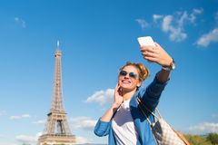 Girl making selfie front of Eiffel Tower in Paris, France. Eiffel Tower Paris, France. happy girl making selfie front of Eiffel Tower in Paris. is traditional Royalty Free Stock Photography