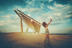 Girl making selfie in front of solar panel royalty free stock images