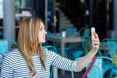 Girl making a selfie with her smartphone Royalty Free Stock Photo