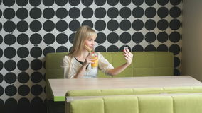 Girl making selfie photo using smartphone stock footage