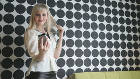 Girl making selfie photo using a smartphone stock video footage