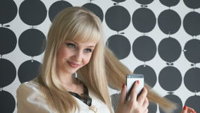 Girl making selfie photo using a smartphone stock footage
