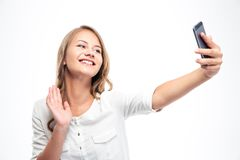Girl making selfie photo while waving palm Stock Photo