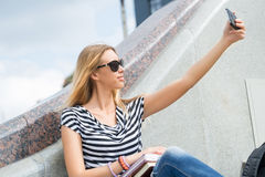 Girl making selfie Stock Photography